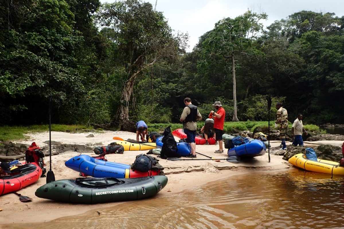 Assembling kit onto rafts on expedition in Gabon