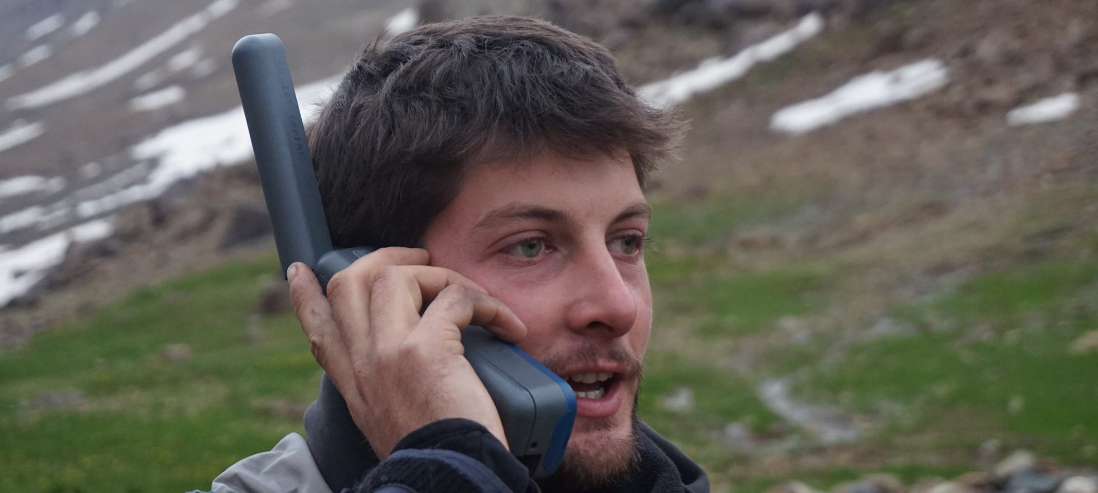 Expedition leader Phil de-Beger keeps in touch using a satellite phone in Kurdistan © Secret Compass