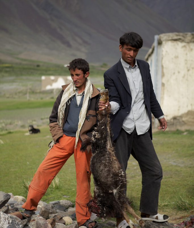 A goat carcass is prepared for a game of buzkashi in Afghanistan's Wakhan Corridor