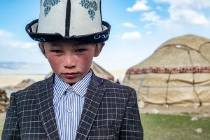 A young boy wearing traiditional Wakhi clothing in Afghanistan's Wakhan National Park