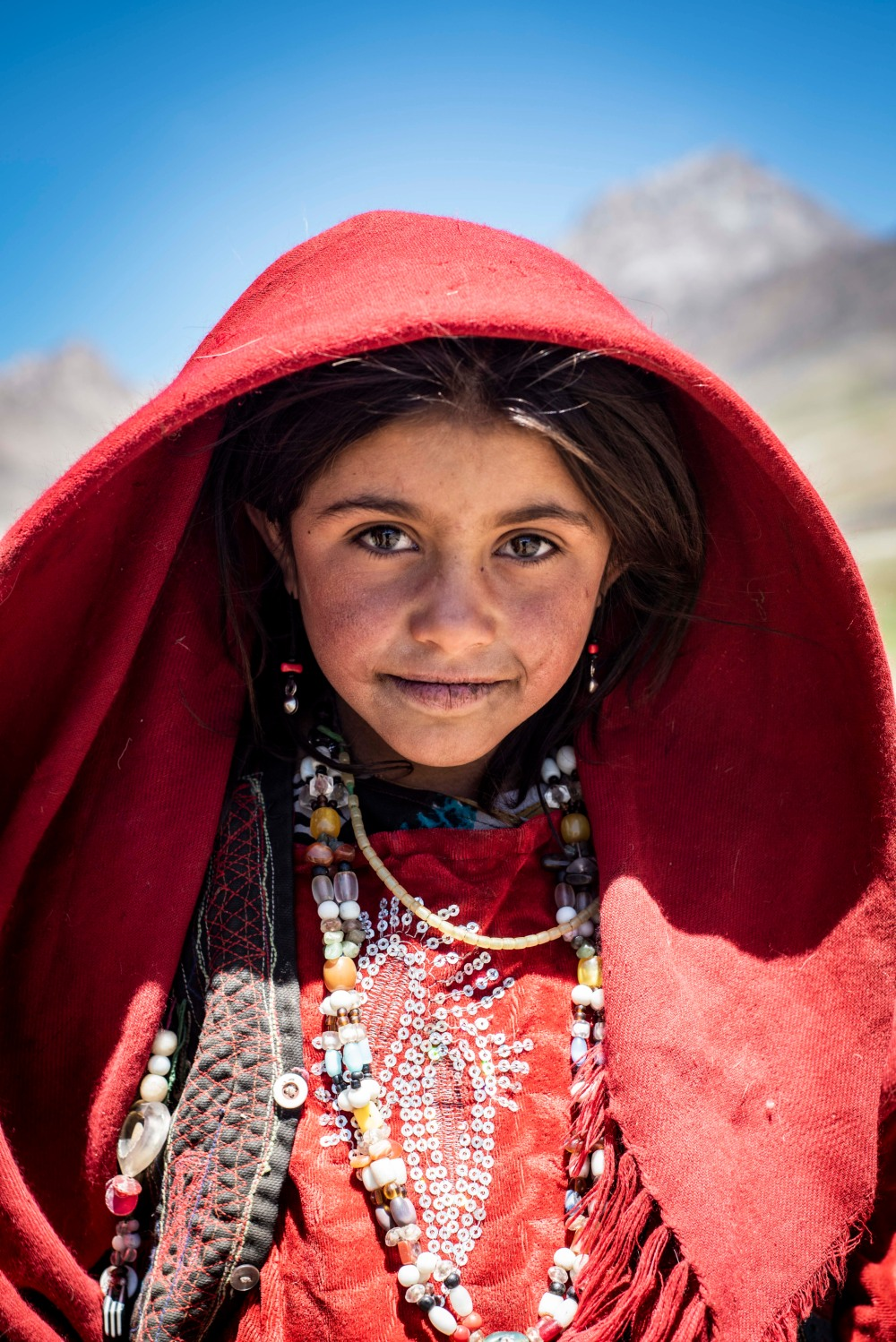 A young girl showcases traditional dress in Afghanistan's Wakhan Corridor